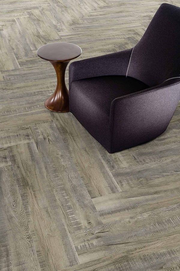Close up picture highlighting the trending 2020 themed herringbone flooring installation pattern.