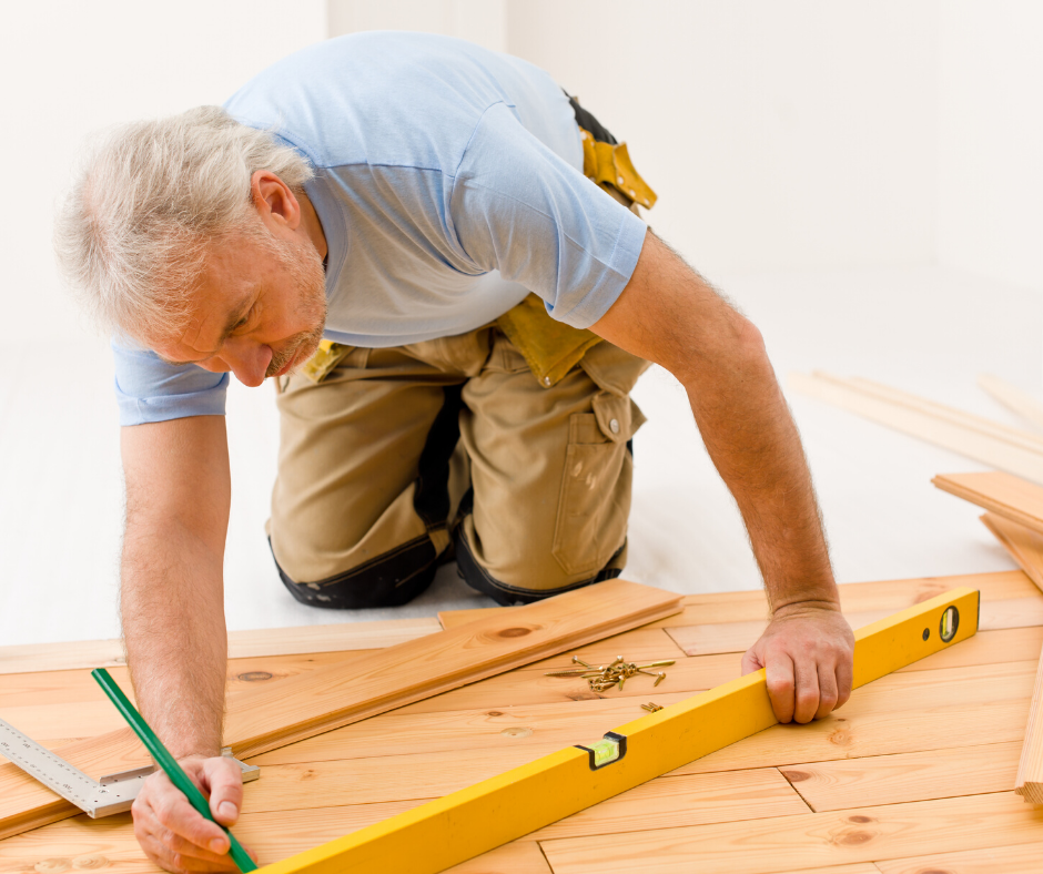 Contractor measuring hardwood flooring