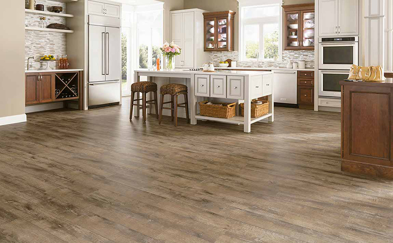 Light Brown Hardwood Floor in Large Light Colored Kitchen