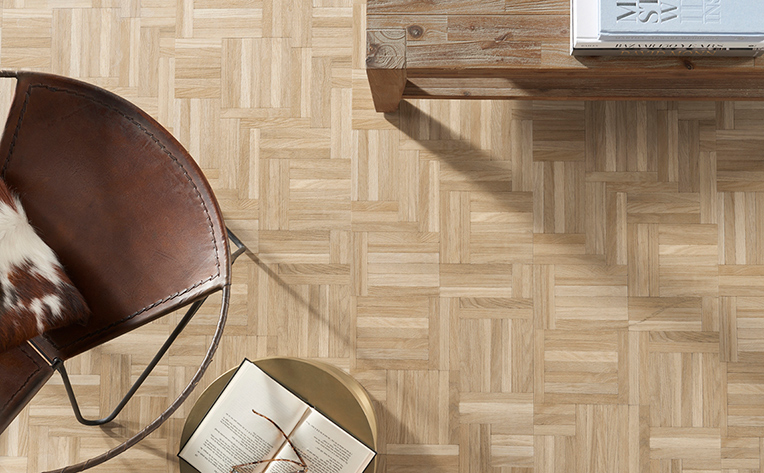 Close up picture of a 2020 themed flooring design that utilizes a natural look and herringbone style design.